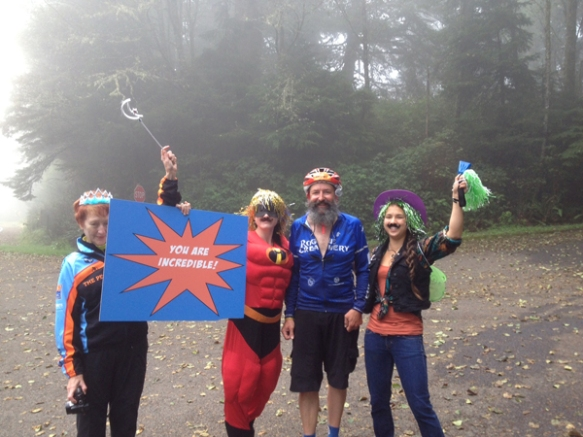 The Beard is greeted by superheroes as he arrives at the top of Cape Lookout, the most difficult climb of the ride.