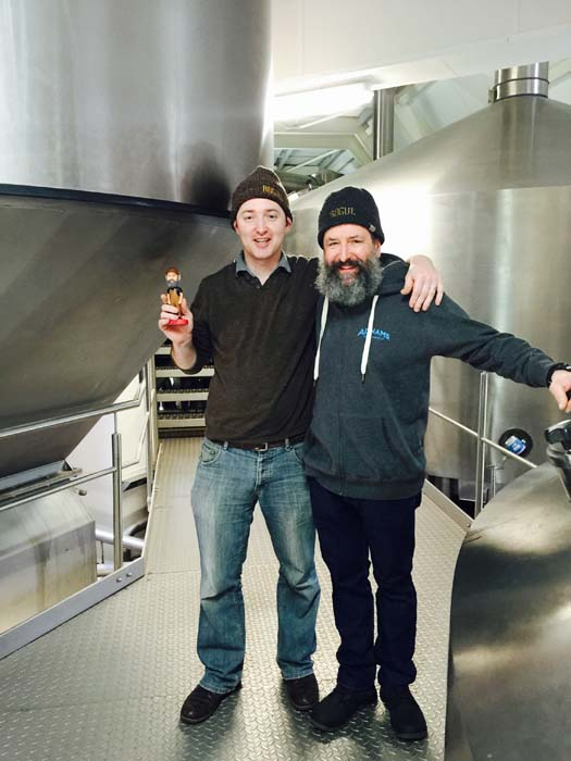 Smiles all around at the completion of brewing, as Mr. Fitzgerald receives his commemorative bobblehead.